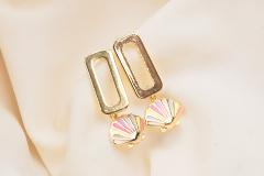 Gold colored earrings & pendants