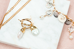 Shell charms and freshwater pearls